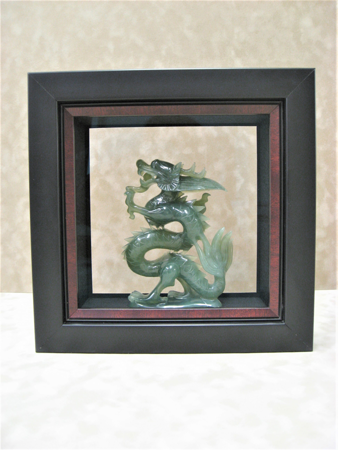 Two-Sided Viewing of Jade Dragon Sculpture